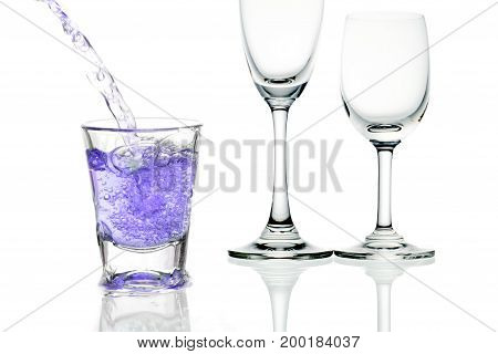 purple cocktail with splashes on white background