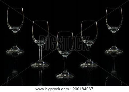 empty wine glass isolated on black background