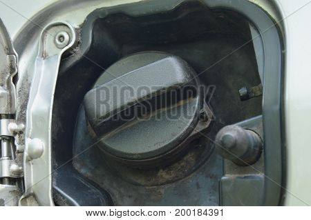 car fuel tank lid opened in the parking