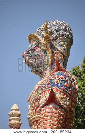 big thai giant statue stand protection temple and mountain background