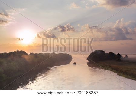 Raft floating on the river at dawn in morning
