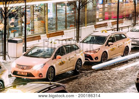 Tallinn, Estonia - December 3, 2016: Toyota Avensis Taxi Cars Parking Near Viru Gates Entrance To Old Part Town Estonian Capital. Tulika Takso is the oldest and largest taxi company in  Estonia