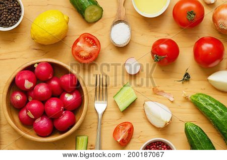 Variety of vegetables for salad on wooden table. Healthy food Diet Clean Eating or Vegetarian concept. Overhead shot