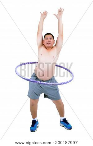 Fat man exercise by playing hula hoop.