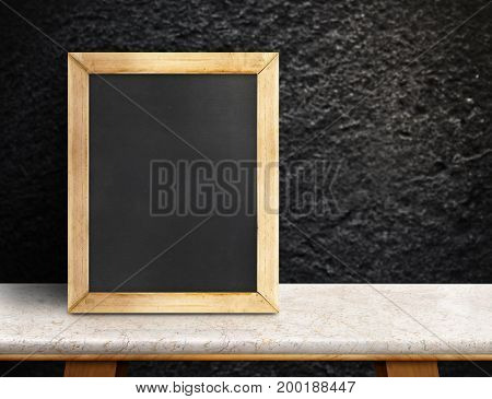 Blank Blackboard On Marble Table At Blurred Rough Black Stone Wall,template Mock Up For Adding Your