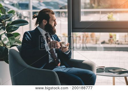 Thoughtful Businessman Drinking Coffee