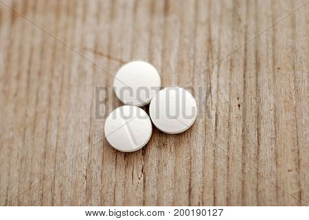 Pills On Wood Background With Shallow Dof