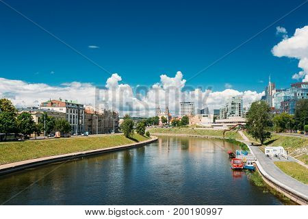 Vilnius, Lithuania  - July 5, 2016: Cityscape With Church Of St Raphael The Archangel And Former Jesuit Monastery, Radisson Blu Hotel In Sunny Summer Day.