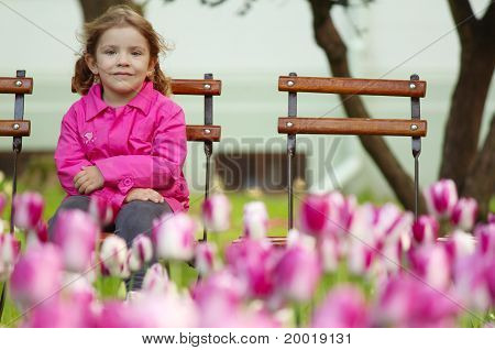 young girl sitting in the park