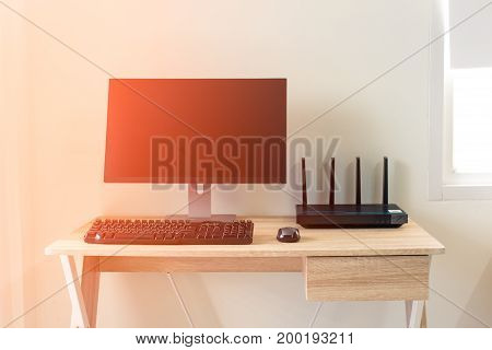 Office Table With Wifi Router And Computer And Supplies