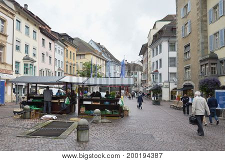 Zurich Switzerland May 30, 2014 : civilian and tourist traffic and buy some product in grocery shop on street of middle Zurich old town