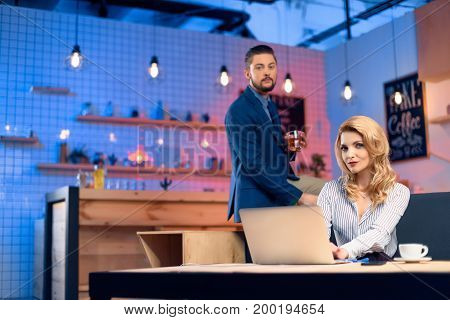 Man Flirting With Woman In Bar