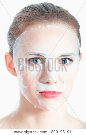 Beautiful young woman with collagen mask.