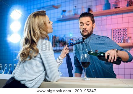 Woman Flirting With Bartender