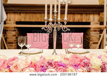 Beautiful Candlestick With Candles On Tables For Newlyweds Decorated With Flowers And Served For Two