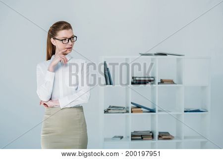 Thoughtful Businesswoman In Office