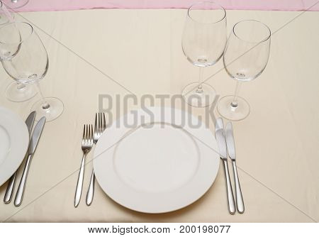 Dinner Place Setting In Restaurant. Empty White Plate With Silver Fork And Knife, Transparent Winegl