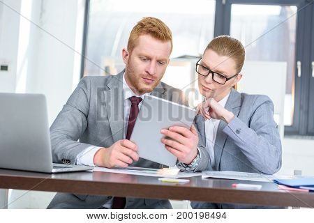 Businesspeople Working With Gadgets