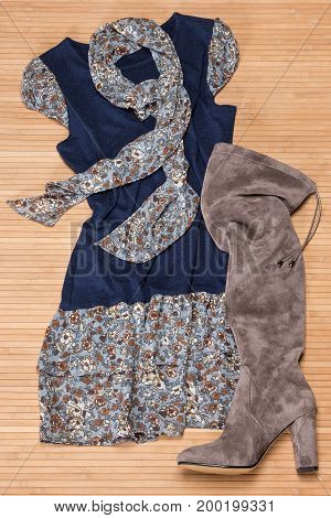 Fashion outfit for women: mini dress with lightweight scarf and over-the-knee high heel boots