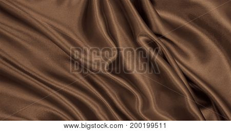 Smooth Elegant Brown Silk Or Satin Texture As Abstract Background. Luxurious Background Design. In S