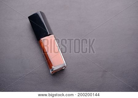 close up of red lipstick isolated on black