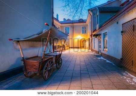 Traditional Old European Medieval Cart Is In Old Night Street Of European Town.
