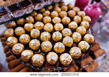 Hai, Ukraine - August 10, 2017: Close-up Photo Of Delicious Pralines In Golden Wrap Called Ferrero R
