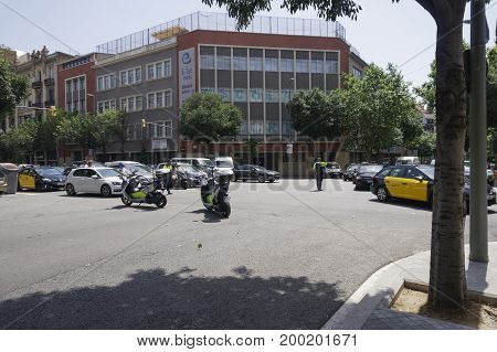 Barcelona, Spain - July 18 2017: Barcelona Police motorcycles blocking traffic. Police men of Guardia Urbana securing road safety on Barcelona city center.