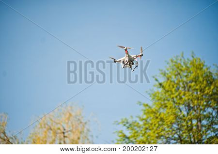 Hai, Ukraine - August 10, 2017: Photo Of A Drone Flying In The Sky Above The Trees.