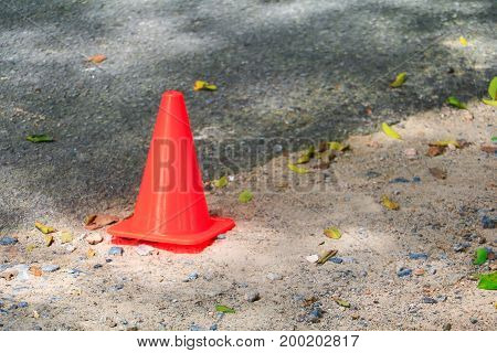 traffic cone small orange on asphalt with copy space