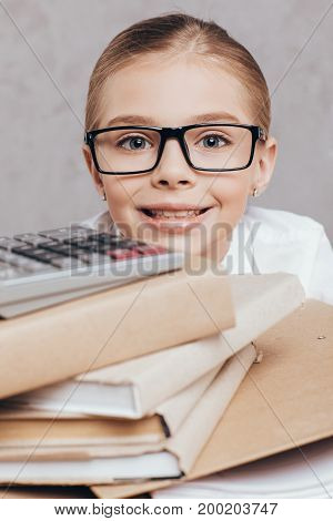 Child With Pile Of Documents