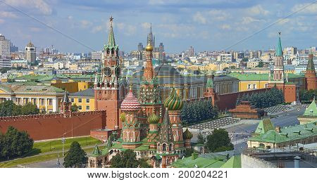 View on Moscow Red Square, Kremlin towers, Clock Kuranti, Saint Basil's Cathedral church, Lenin mausoleum. Panorama Hotel Russia. Moscow holidays vacation tours famous sightseeing. Moscow Red Square