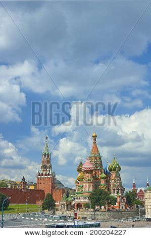 Moscow Red Square, Kremlin towers, stars and Clock Kuranti, Saint Basil's Cathedral church. Moscow holidays vacation tours famous sightseeing points.. poster