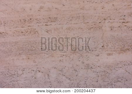 Closeup of a Moroccan Red Adobe Mud Wall as background.