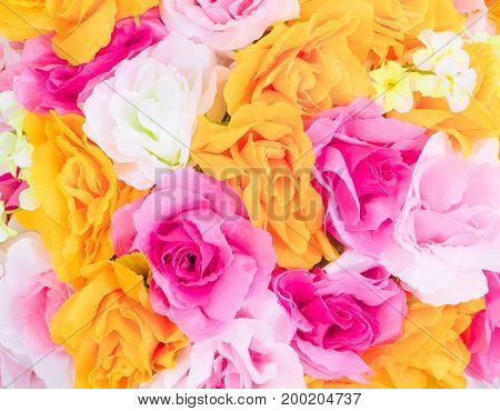 colorful rose flower from fabric multicolored beautiful background with copy space add text