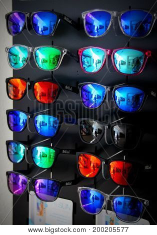 Colorful reflections in sun glasses. Bright things.