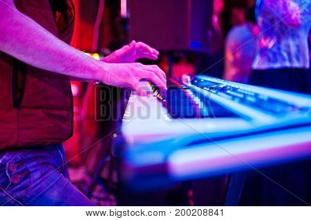 Close-up Photo Of Musician's Hands Playing The Synthesizer In The Nightclub.