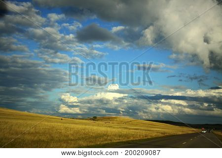 Autumn blue sky with white and grey clouds