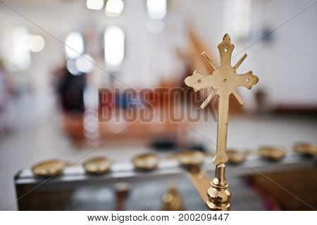 Close-up Photo Of A Golden Cross In The Church.