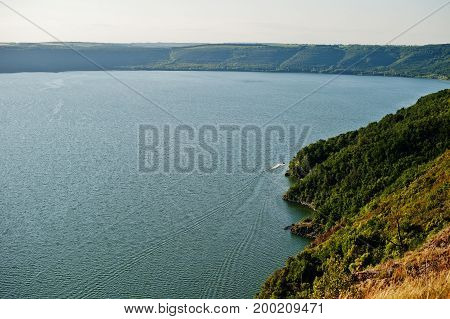 Absolutely Stunning, Breathtaking And Picturesque View Of Lake Surrounded By Hills And Mountains.