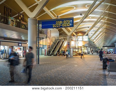 Shanghai, China - Nov 6, 2016: In Shanghai Pudong International Airport. Image features commercial shops and passenger departure area.