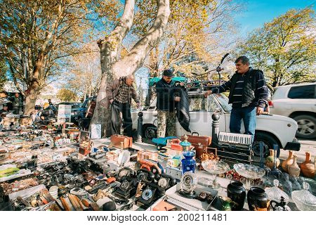 Tbilisi, Georgia - October 29, 2016: Men Trading Second-hand Things And Antiquities In Flea Market Of Antiques Old Retro Vintage Things On Dry Bridge In Tbilisi. Swap Meet