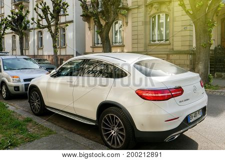 STRASBOURG FRANCE - APR 12 2017: Luxury Mercedes-Benz GLC 220 car parked in center of typical French city of Strasbourg. is a compact luxury SUV introduced in 2015 for the 2016 model year that replaces the former Mercedes-Benz GLK-Class