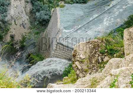 Beautiful image of big stone wall used for mountain river bank protection