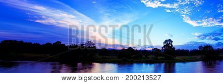 panorama sunset in sky reflex river beautiful colorful landscape silhouette tree woodland twilight time with copy space add text