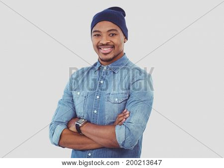 Digital composite of Portrait of man with folded arms with grey background