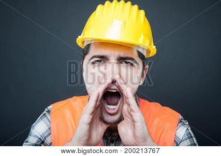 Close-up Of Constructor Wearing Hardhat Screaming