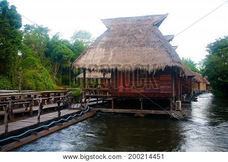 Wooden bungalows on the water on the river Kwai. Thailand.