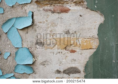 remnants of old blue paint on concrete wall