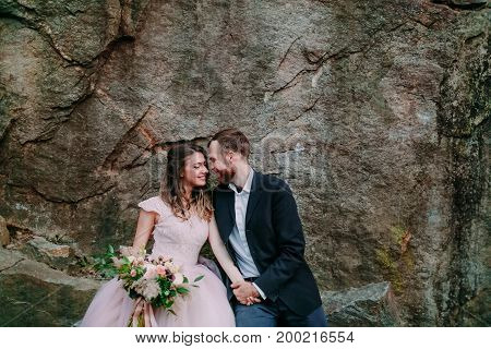 Attractive Couple Newlyweds Bride And Groom Laughs And Smiles To Each Other, Happy And Joyful Moment